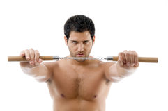 Portrait of young man with nunchaku Royalty Free Stock Image