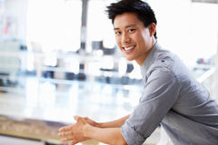 Portrait of young man in office smiling royalty free stock photos