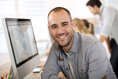 Portrait of young man office worker in computer Stock Photo
