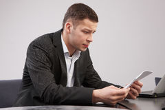 Portrait of young man in the office working Royalty Free Stock Photography