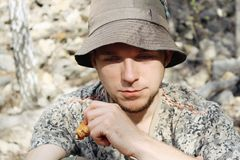 Portrait of young man outdoor. Portrait of young attractive man in hat Stock Image