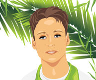 Portrait of a young man among palm branches Stock Images