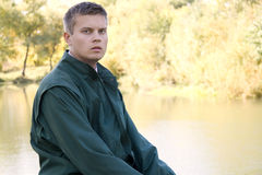 Portrait of Young man in park Stock Images