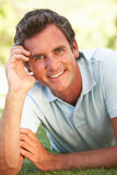 Portrait Of Young Man In Park Royalty Free Stock Photos