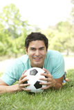 Portrait Of Young Man In Park With Football Royalty Free Stock Image