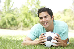 Portrait Of Young Man In Park With Football Royalty Free Stock Photos