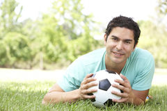 Portrait Of Young Man In Park With Football Royalty Free Stock Images