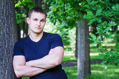 Portrait of a young man in a park Stock Image