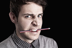 Portrait of a young man with pencil Stock Photography
