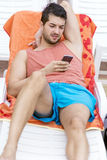 Portrait of young man  with phone in the hands Royalty Free Stock Photography