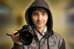 Portrait of young man photographer with camera Stock Image
