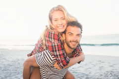 Portrait of a young man piggybacking beautiful woman Royalty Free Stock Photography