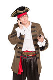 Portrait of young man. In pirate costume talking on the phone. Isolated Royalty Free Stock Photos