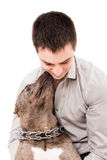 Portrait of a young man and a pit bull Royalty Free Stock Image