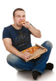 Portrait young man with a pizza Stock Photos