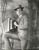 Portrait of young man playing accordion Stock Photography