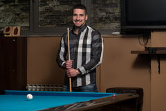 Portrait Of A Young Man Playing Billiards. Portrait Of A Young Man Concentration On Ball Stock Images