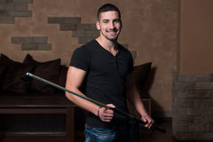 Portrait Of A Young Man Playing Billiards. Portrait Of A Young Man Concentration On Ball Royalty Free Stock Photos