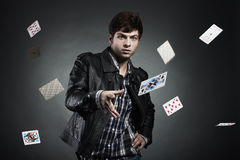 Portrait of the young man playing cards Stock Images
