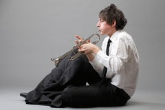 Portrait of a young man playing his Trumpet Royalty Free Stock Photos