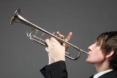 Portrait of a young man playing his Trumpet Royalty Free Stock Images