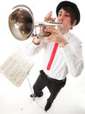Portrait of a young man playing his Trumpet Royalty Free Stock Photography