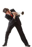Portrait of young man playing his Trumpet plays. Portrait of a young man playing his Trumpet plays isolated white background Royalty Free Stock Photo