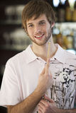 Portrait of a young man playing pool Stock Photos