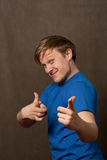 Portrait of a young man in pointing at camera Royalty Free Stock Images