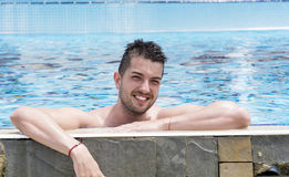 Portrait of young man in a pool Royalty Free Stock Image