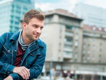 Portrait of young man posing on the street, profile of handsome guy Stock Photos