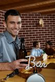 Portrait of young man in pub Royalty Free Stock Image