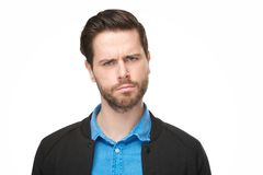 Portrait of a young man with a questioning thinking face. Close up portrait of a young man with a confused, thinking face Royalty Free Stock Images