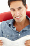 Portrait of young man reading Royalty Free Stock Photo