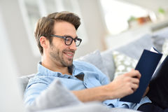 Portrait of young man reading a book Royalty Free Stock Image