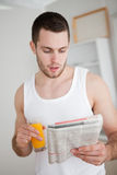 Portrait of a young man reading the news Stock Images