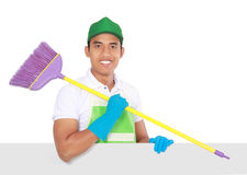 Portrait of young man ready to do some cleaning. presenting copy. Portrait of young man wearing glove ready to do some cleaning. presenting copyspace royalty free stock photography