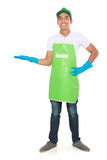 Portrait of young man ready to do some cleaning. presenting copy. Portrait of young man wearing glove ready to do some cleaning. presenting copyspace Royalty Free Stock Photo
