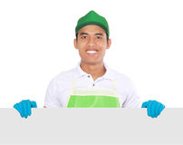Portrait of young man ready to do some cleaning. presenting copy. Portrait of young man wearing glove ready to do some cleaning. presenting copyspace Stock Photos