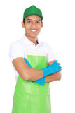 Portrait of young man ready to do some cleaning. Portrait of young man wearing glove ready to do some cleaning stock image