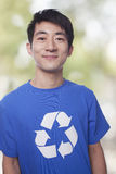 Portrait of young man with recycling t-shirt Royalty Free Stock Image