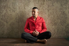 Portrait of a young man, in red shirt and black slacks, hairstyl Royalty Free Stock Image