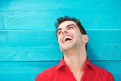 Portrait of a young man in red shirt laughing Royalty Free Stock Photo