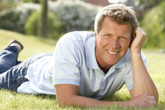 Portrait of young man relaxing in countryside Stock Photos