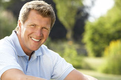 Portrait of young man relaxing in countryside stock photography