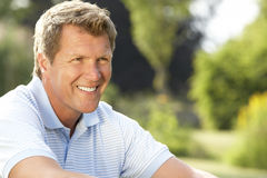 Portrait of young man relaxing in countryside Stock Images