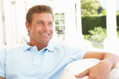 Portrait Of Young Man Relaxing On Sofa Royalty Free Stock Photography