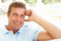 Portrait Of Young Man Relaxing On Sofa Stock Photos