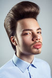 Portrait of young man with retro classic pompadour hairstyle. Studio shot. looking at camera Stock Photos