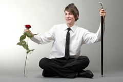 Portrait young man and rose enamoured love Royalty Free Stock Image